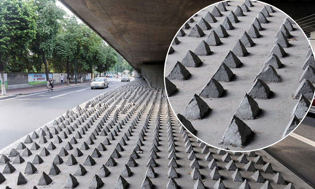 Sharp concrete spikes are cropping up under China's city bridges in a bid to stop homeless people from sleeping there.