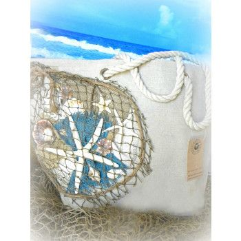 Our exquisite one of a kind beach inspired tote bag is designed of canvas and all natural dried materials . This original Abode Decor design is embellished with burlap, rope, authentic seashells and starfish�truly eye-catching!  Perfect for use at the beach and pool or just a great tote for running around town!  The lining has a drawstring closure making it an amazing �hold all� summer handbag.>Off white canvas with starfish and shells..($40)