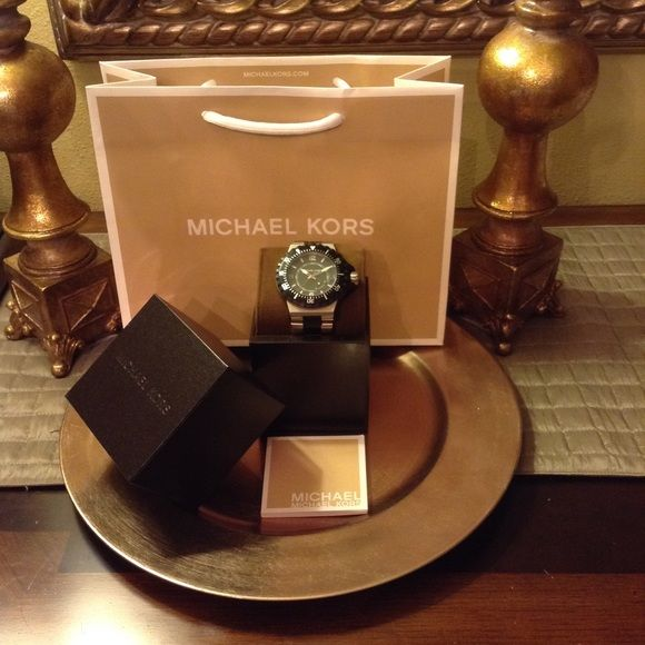 Authentic Michael Kors Watch Authentic Michael Kors, MK 7059, Large Black Facing, Large Black Bezel, Two Toned Black & Silver Band, Box & Manual Included, Like New! Michael Kors Accessories Watches