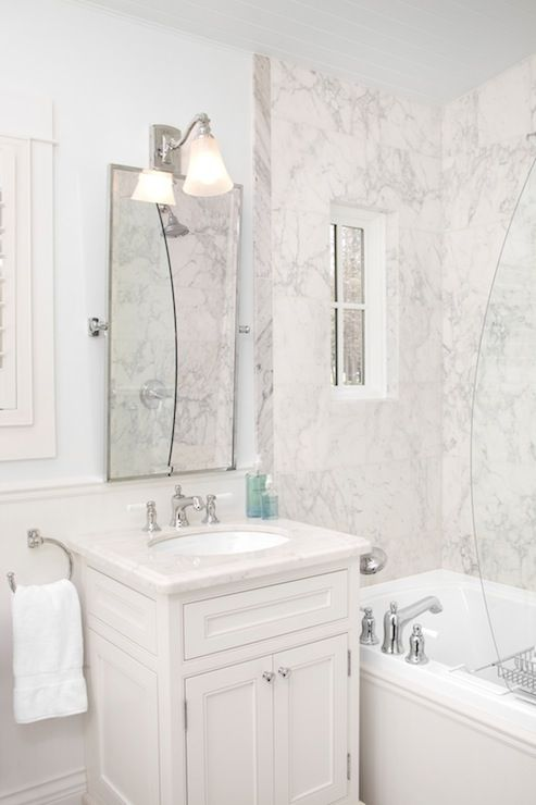 The Art Gallery Beautiful bathroom with single white vanity paired with a marble countertop and pivot mirror topped lit