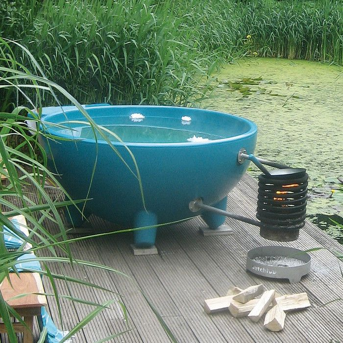 I was thinking about building a wood solar powered hot tub for Outdoor bathtub wood fired