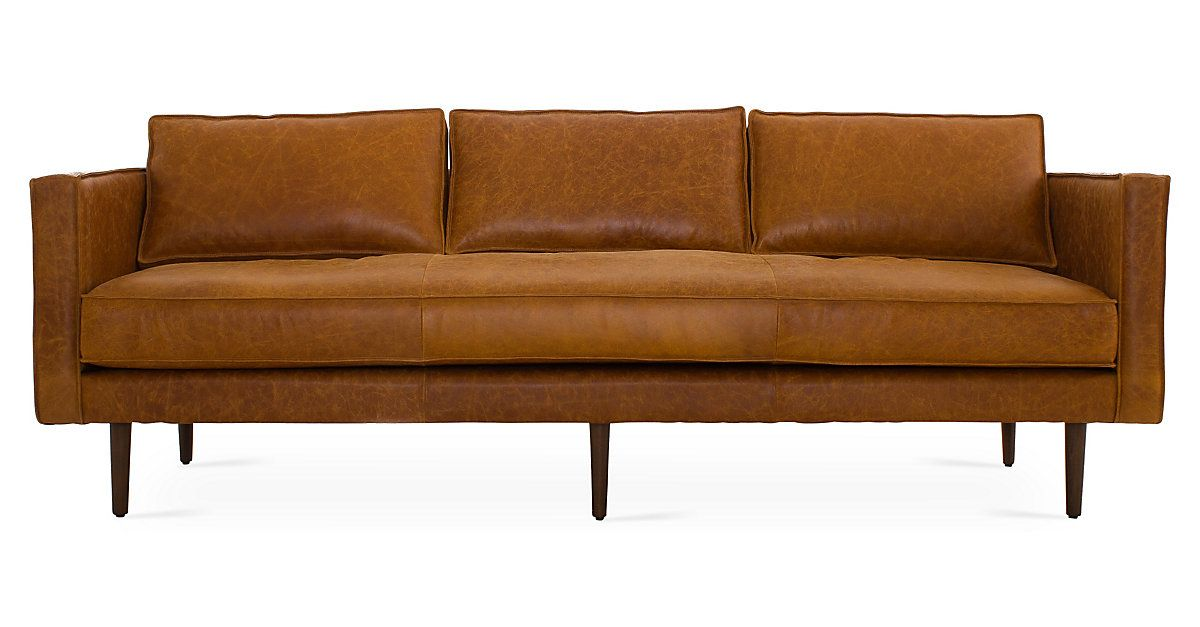This Midcentury Inspired Sofa Held In Place By Tapered Hardwood Legs Is Expertly Handcrafted With Su Leather Sofa Brown Leather Couch Brown Leather Furniture