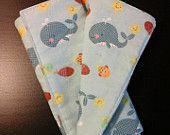 A-Doodles Whaling Burp Cloth. Made with flannel, this burp cloth measures 10 x 18 inches with an absorbent insert of a needled cotton batting.