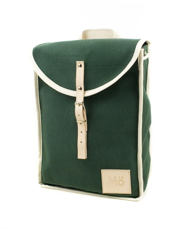 """Vintage inspired backpack,… a tribute to the shape of retro climbers  bags. Practical, light and easy to carry. Handcrafted street style.Natural  600g green cotton canvas and natural leather engraved logo. Interior  reinforcements made of natural leather. Nautical cotton drawstring. Non  abrasive metal buckles. Organic cotton adjustable handles. Handmade in  Spain.It fits a 13"""" laptopHeight: 35cm x Width: 27cm x Depth: 10cm Flap Length: 32cm     Mödernaked      Manufactured by: Mödernaked"""