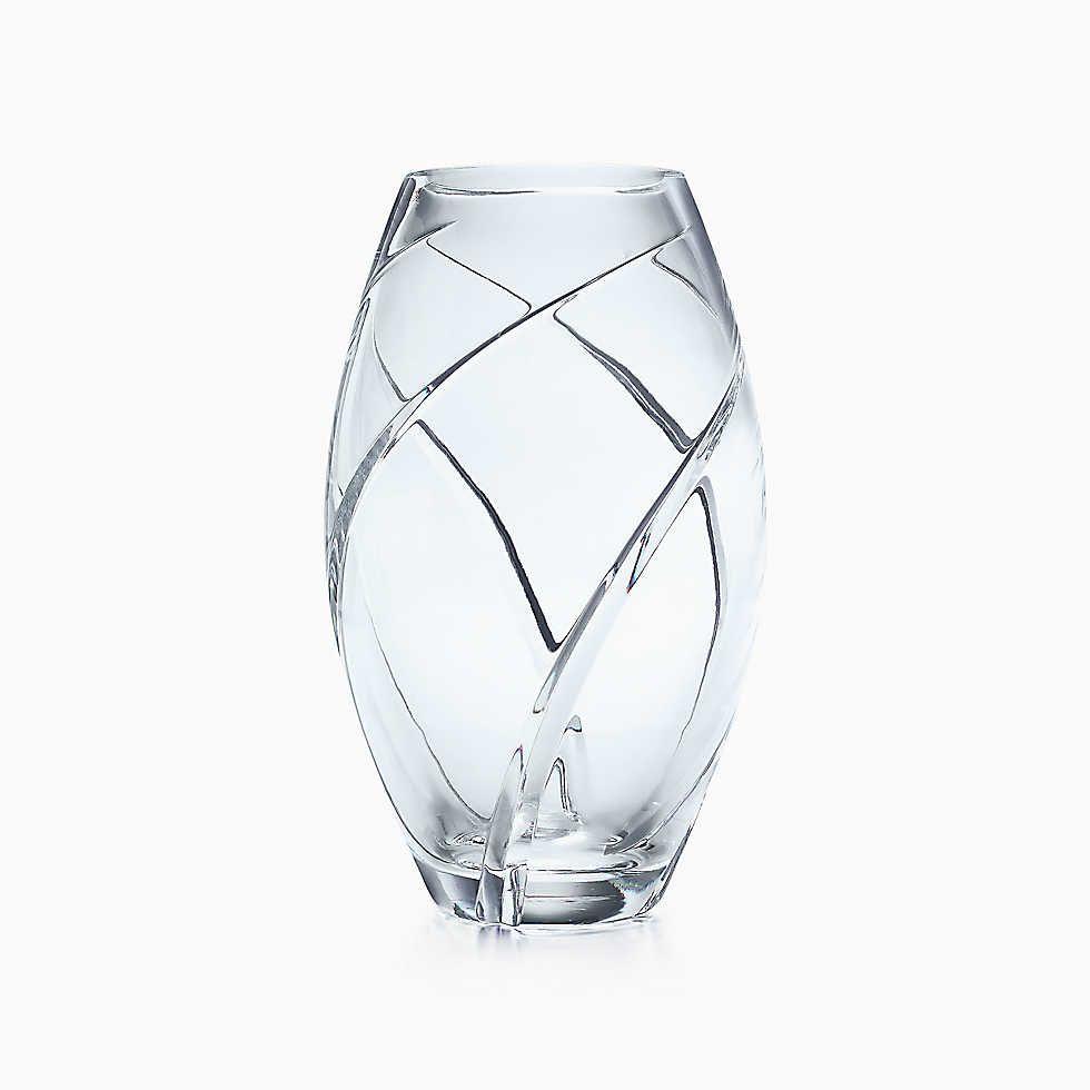Swirl-cut elliptical vase in hand-cut crystal.