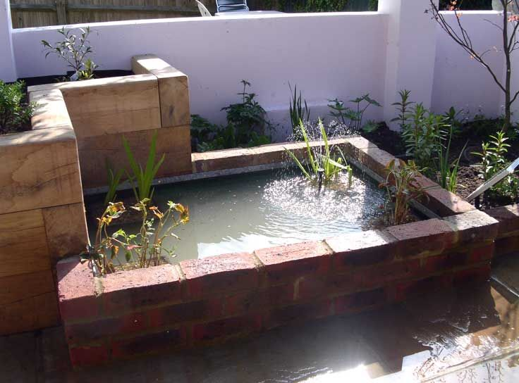 Semi raised pond in flower bed hove garden pond raised for Raised fish pond designs