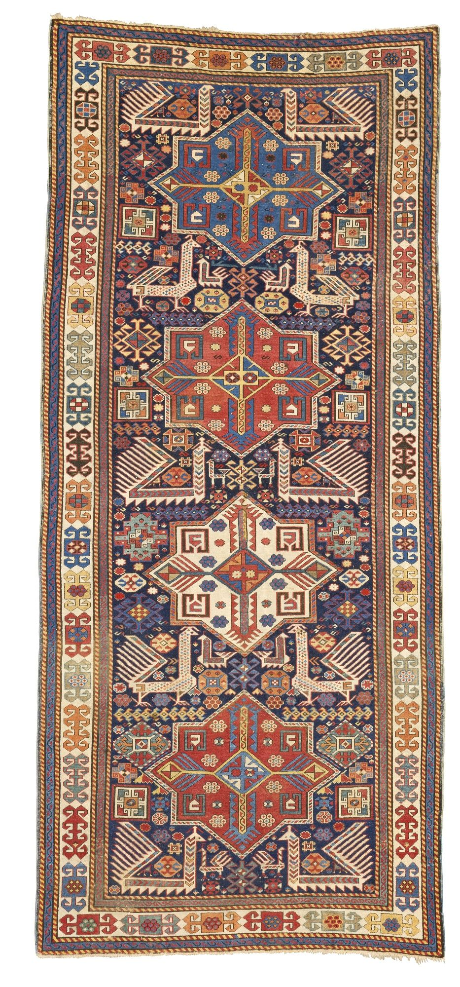 An Akstafa rug, East Caucasus approximately 294 by 127cm; 9ft. 8in., 4ft. 2in. circa 1875