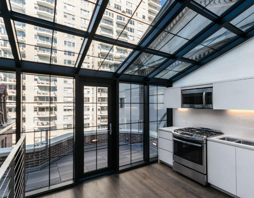 A Glass Enclosed Space From Which To Enjoy The Sun Moon And Sky
