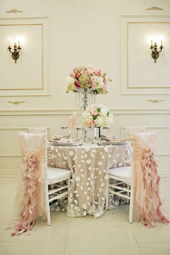Love the tablecloth overlay and the subtle peach hues.