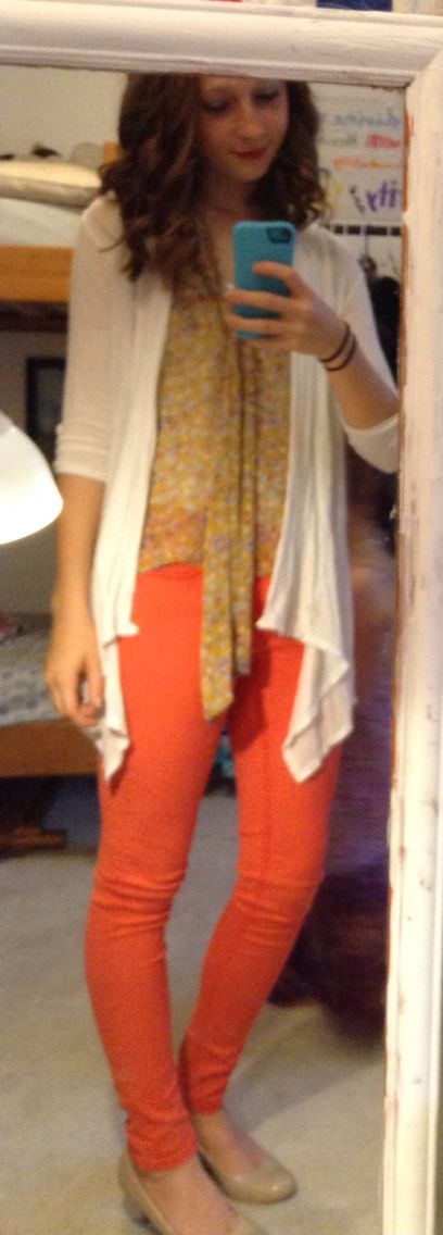 cute outfit; yellow floral tank top, off white cardigan, red/orange skinny jeans, nude heels