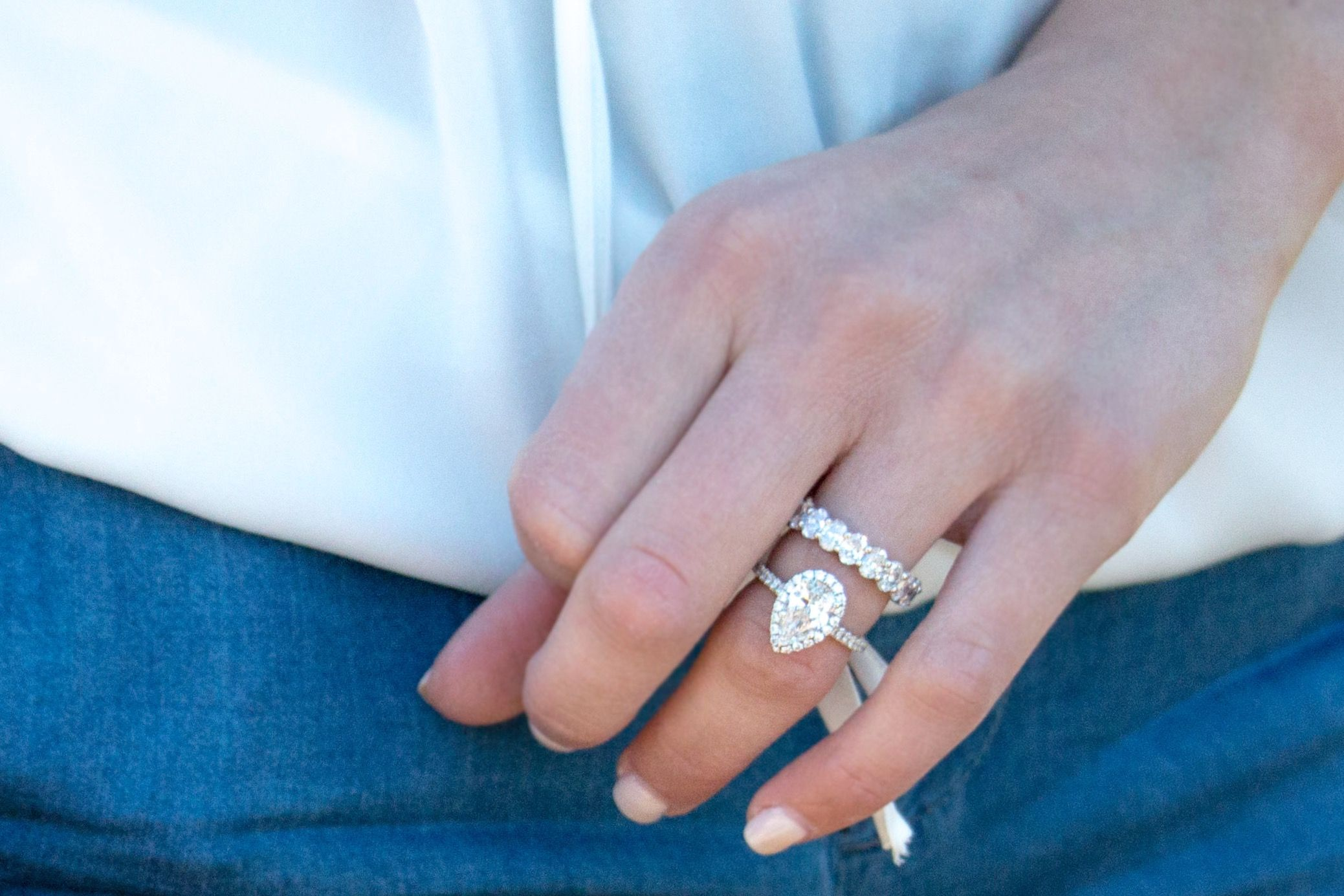 Pear shaped engagement ring with oval shaped eternity band wed