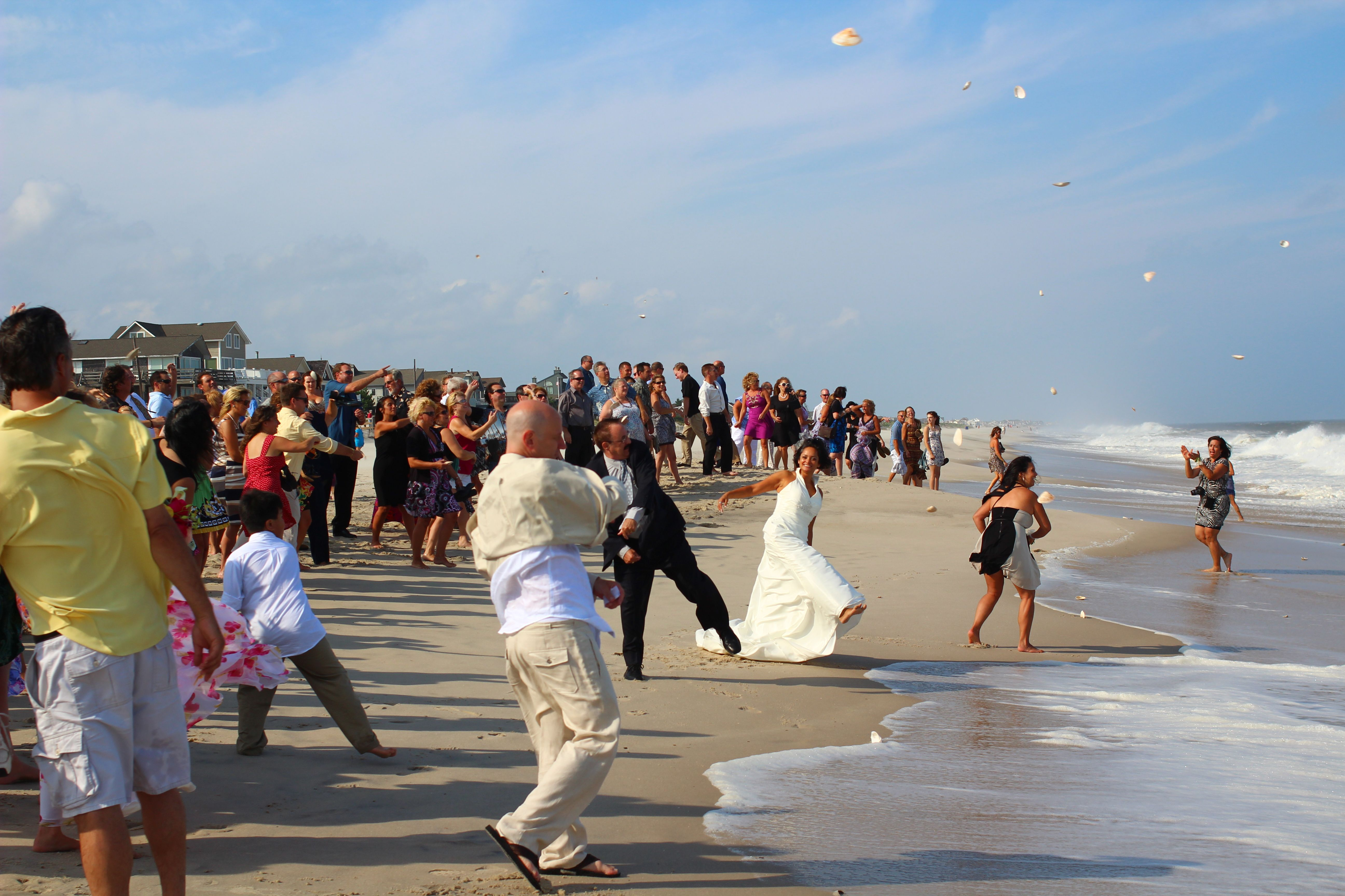 Have A Seashell Toss With Your Guests After Your Beach Wedding
