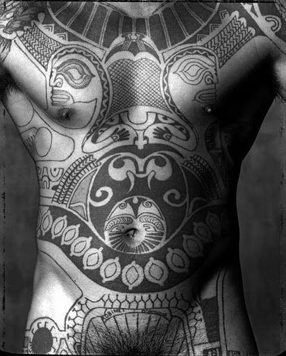 Photo shot by (the famous) Gian Paolo Barbieri, 1989, Tahiti. No further info. Don't particularly envy this as such, but the composition is inspiring for other tats (perhaps elsewhere on the body).