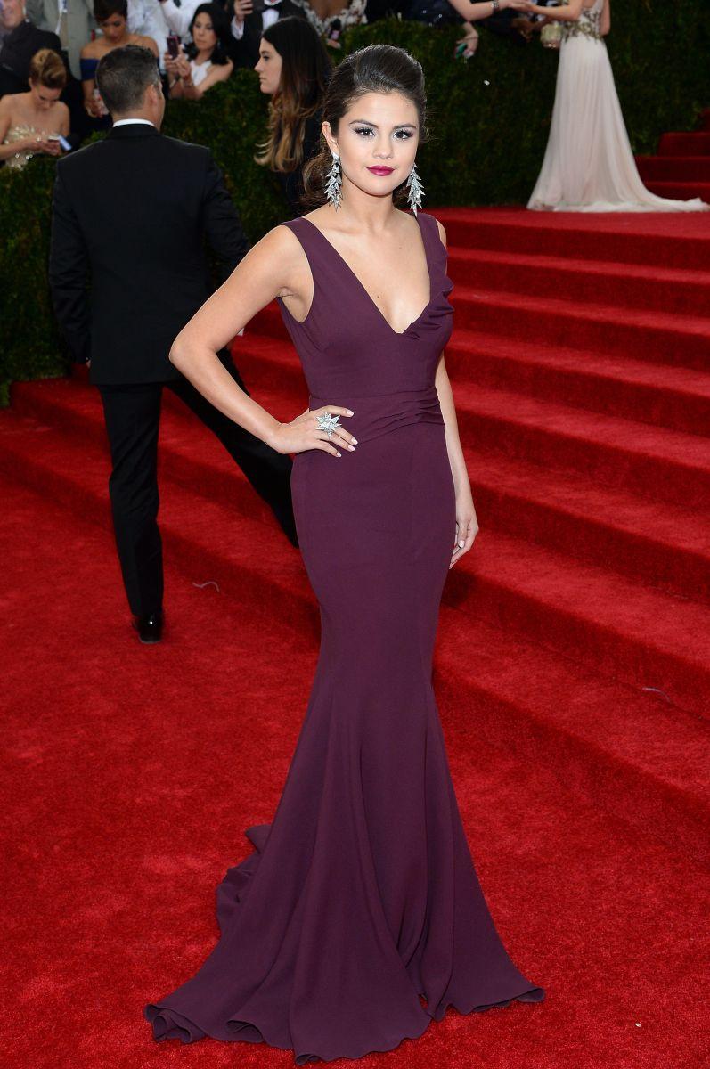 Selena Gomez in a deep burgundy dress by Diane Von Furstenberg ...