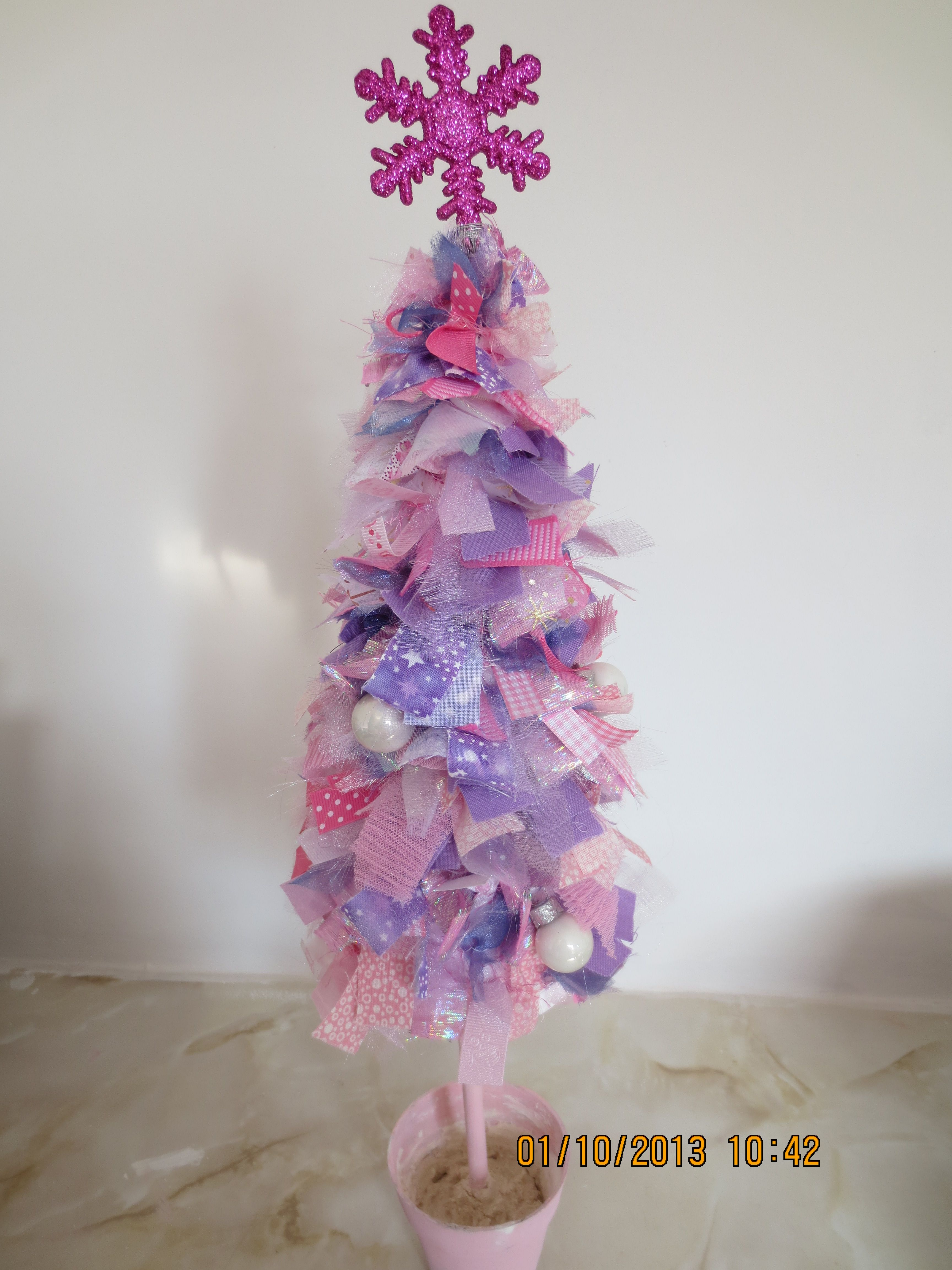 polystyrene cone decorated with ribbons and baubles