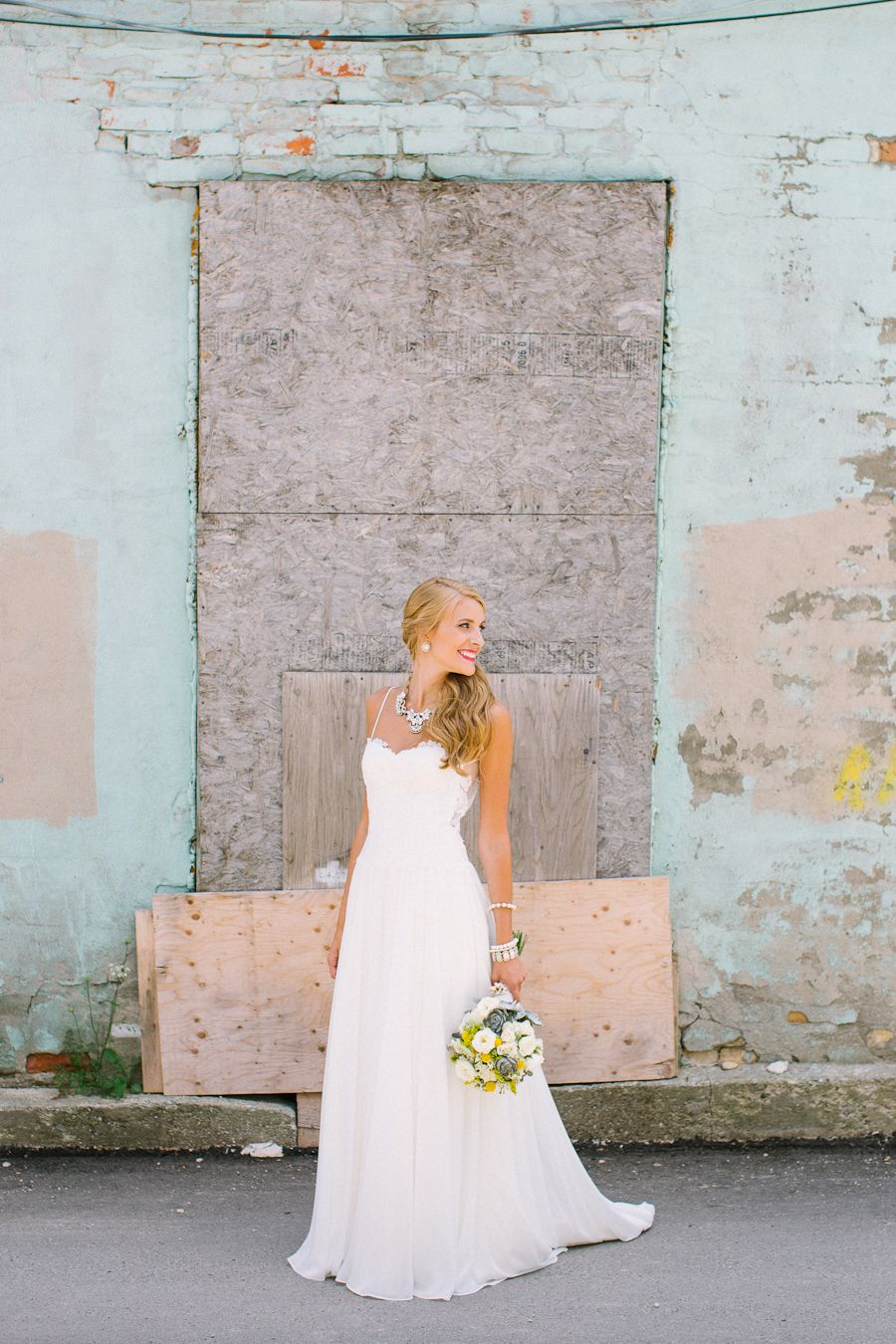 Fun bride u groom blue and yellow wedding photo andrew mark