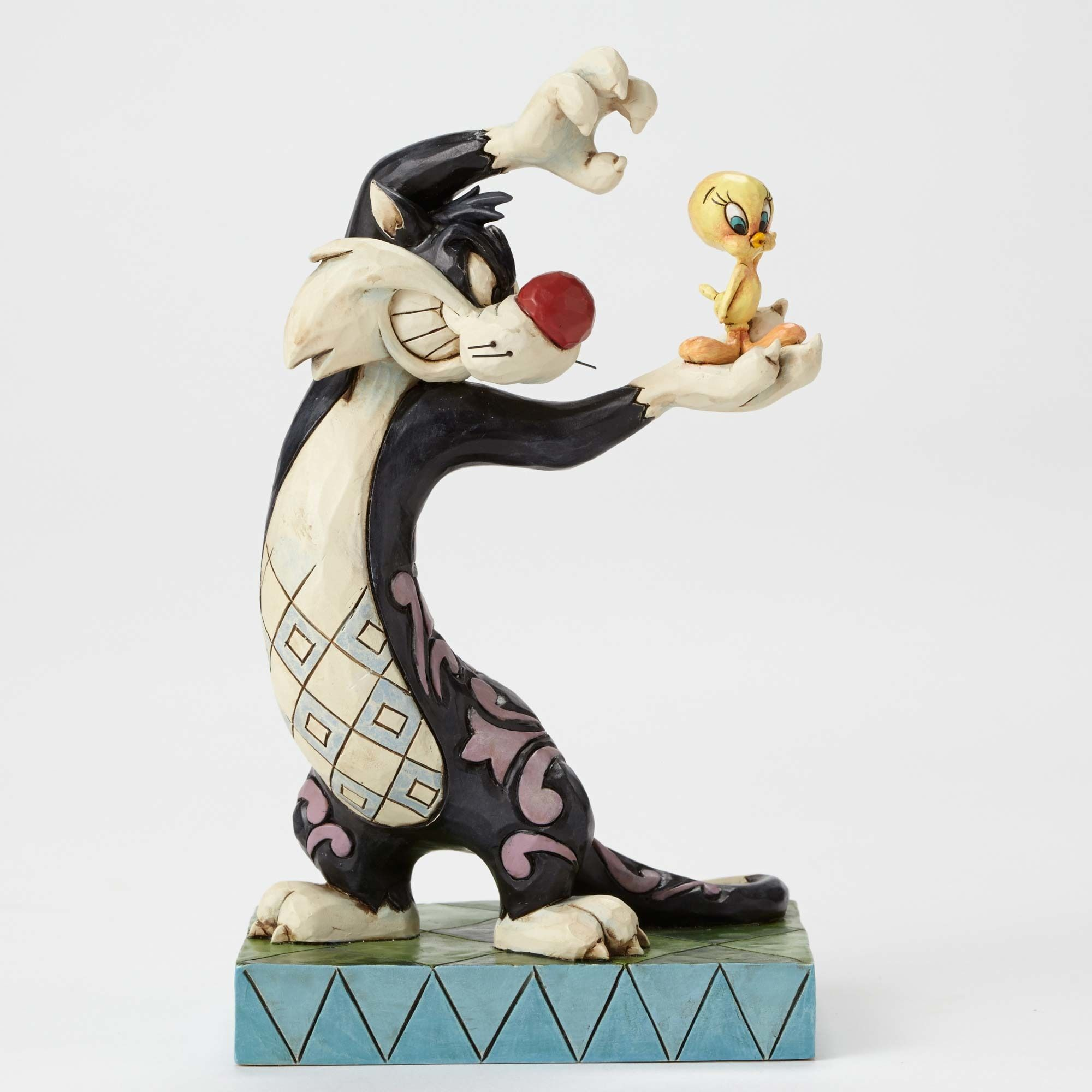 Sylvester eyes a tasty morsel he'll never be able to catch in this wishful-thinking design from Jim Shore's whimsical new collection featuring the beloved characters from the classic Looney Tunes cartoons.