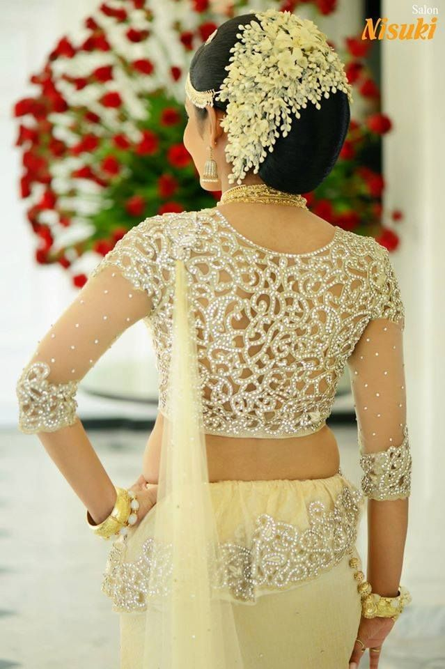 What A Beautiful Large Low Bun With Real Flower Gajra Care However Should Be Taken Before Adopting Bridal Blouse Designs Indian Bride Hairstyle Saree Designs