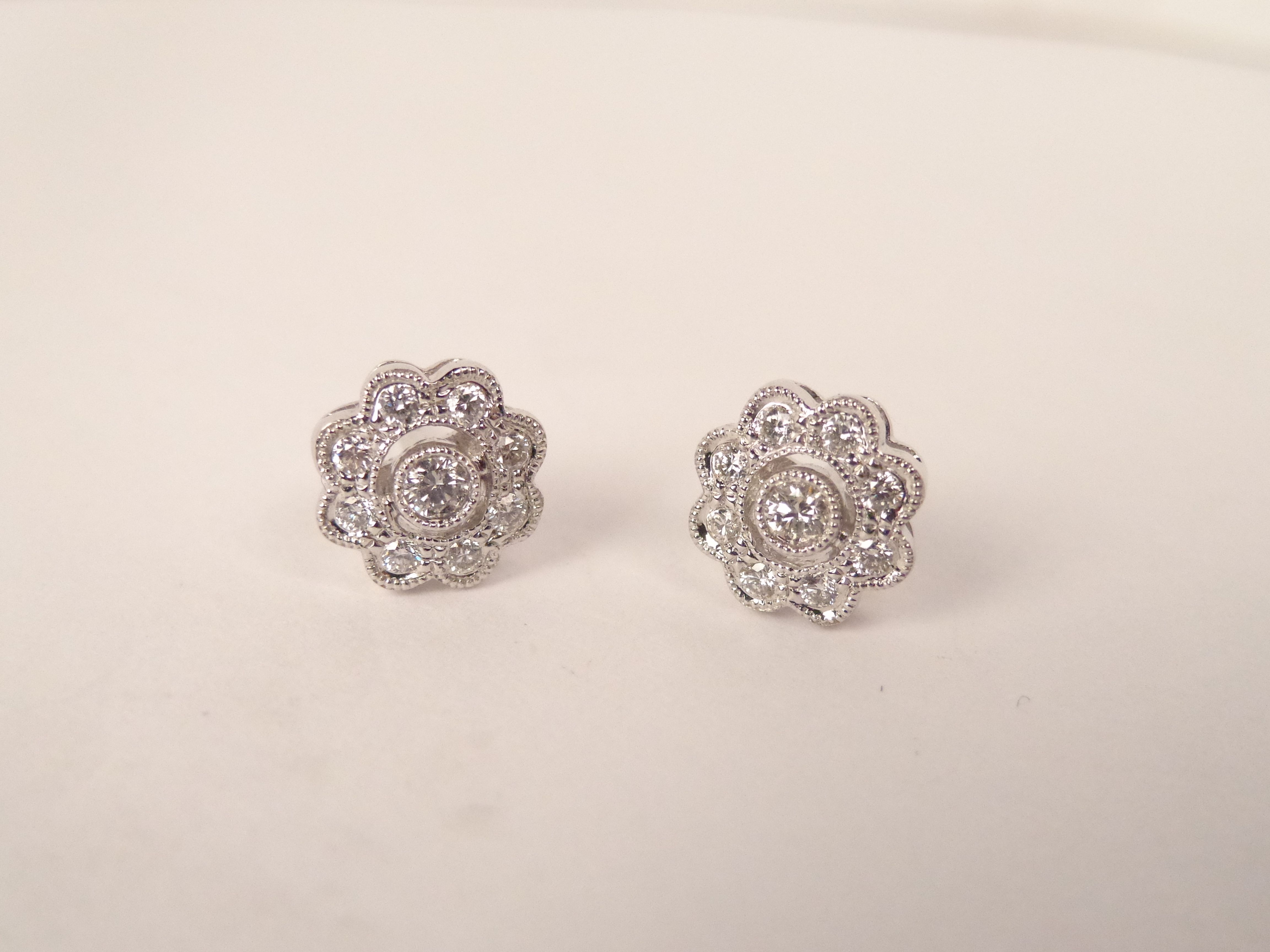 14K, .40 ct milgrained flower petal style earrings, $860, hhorwitz.com