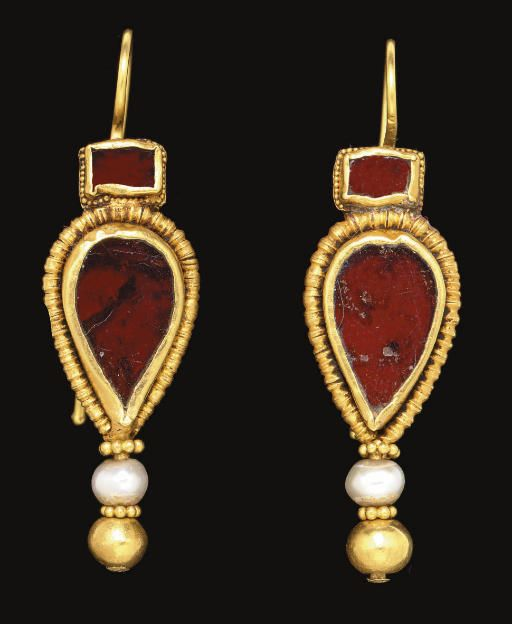 A PAIR OF BYZANTINE GOLD, GARNET AND PEARL EARRINGS CIRCA 4TH-5TH CENTURY A.D. Each with a rectangular box bezel encircled by beaded wire, set with a garnet, surmounting a drop-shaped box bezel encircled by beaded wire, set with a garnet, threaded through a pearl and a hollow gold sphere, a ring of beaded wire above each, hinged at the back; now joined to modern earwires