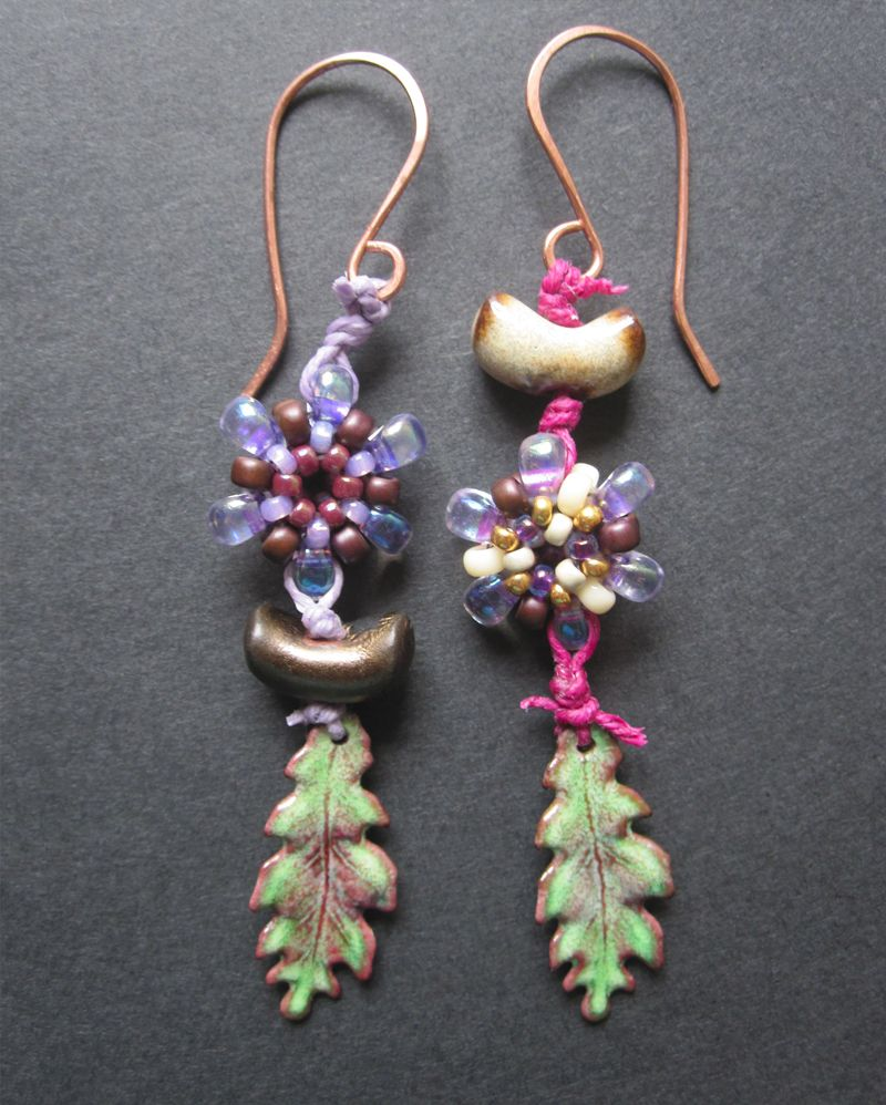 Earrings by Malin de Koning. Beaded beads by Malin de Koning. Ceramic beads by Elaine Ray. Enameled leafs by Gardanne.