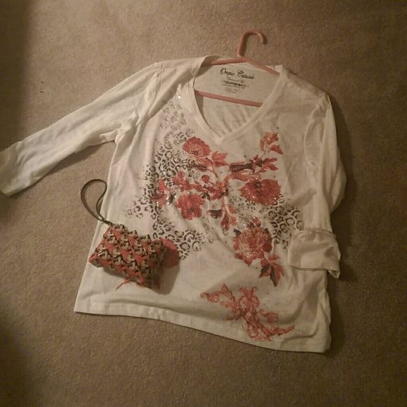 Beaded casual shirt This is a white shirt with black leopard print and orangish coral flowers with rhinestones. Sleeves are 3/4 length. Size is Xl but runs small. I have never worn it was a gift and it didn't fit. Onque Casuals Tops