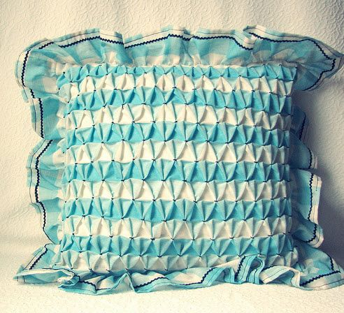 This is a lot like the pink pillow I had on my bed for years!  My grandmom and mom both did smocking and I treasure the things those talented women made!