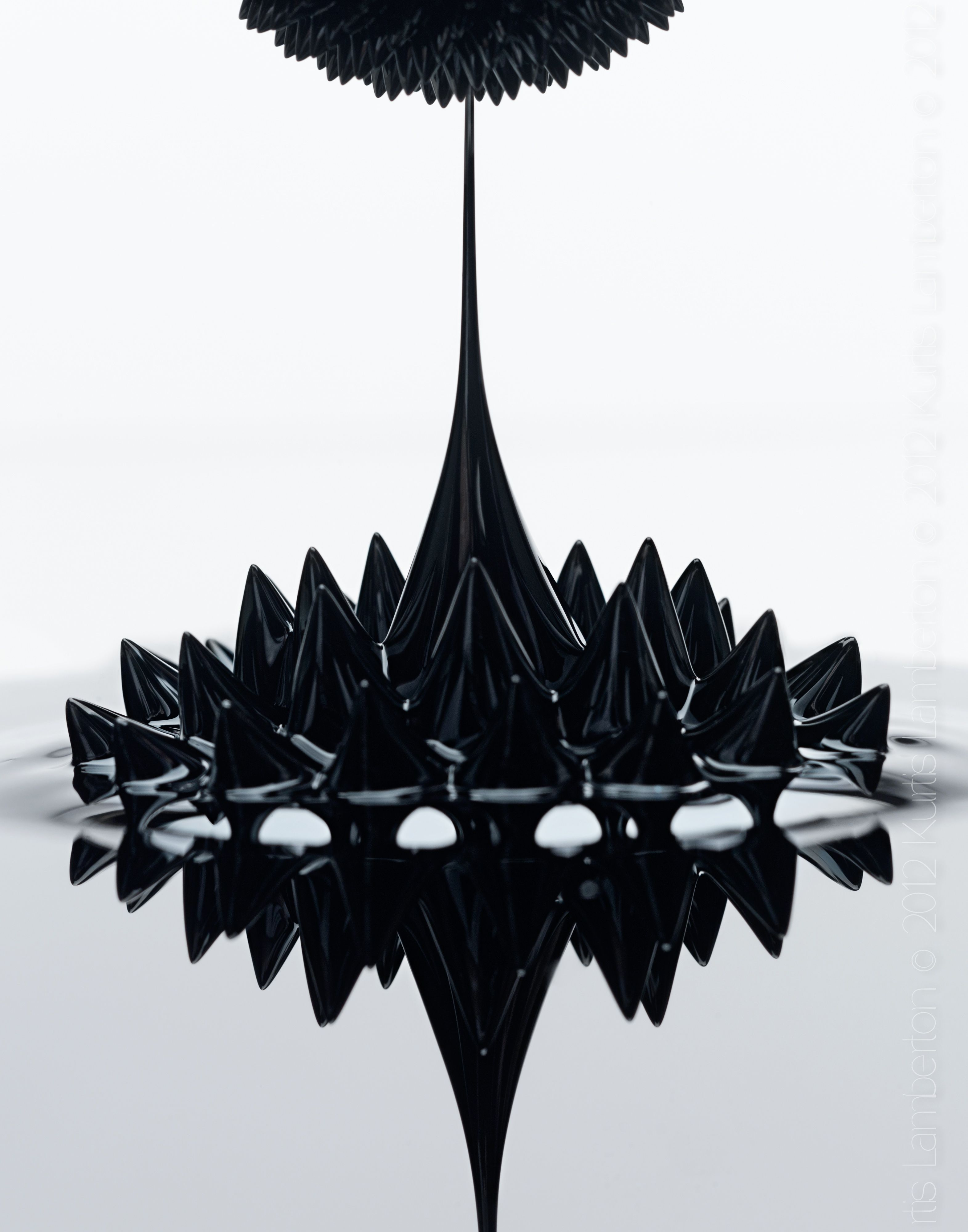 Ferrofluid: magnetic influence made visible.    Ferrofluids are liquids which magnetise strongly when exposed to magnetic feilds. Large ferromagnetic particles can be ripped out of the homogeneous colloidal mixture (the liquid), forming a separate clump of magnetic dust when exposed to strong magnetic fields.