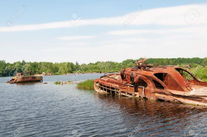 Pictures Of The Abandoned Vehicles Of Chernobyl - Some of the boats in the Chernobyl boat yard were used in the clean up operation. Others were in the wrong place at the wrong time and abandoned.