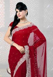 Be your own style diva with this maroon faux georgette saree.  This drape is nicely designed with sequins, Cutdana, Beads and stone work. As shown blouse can be made available and also can be customized as per your style or pattern subject to fabric limitation. Slight variation in color is possible. 231 instead of 330/-  SMV127