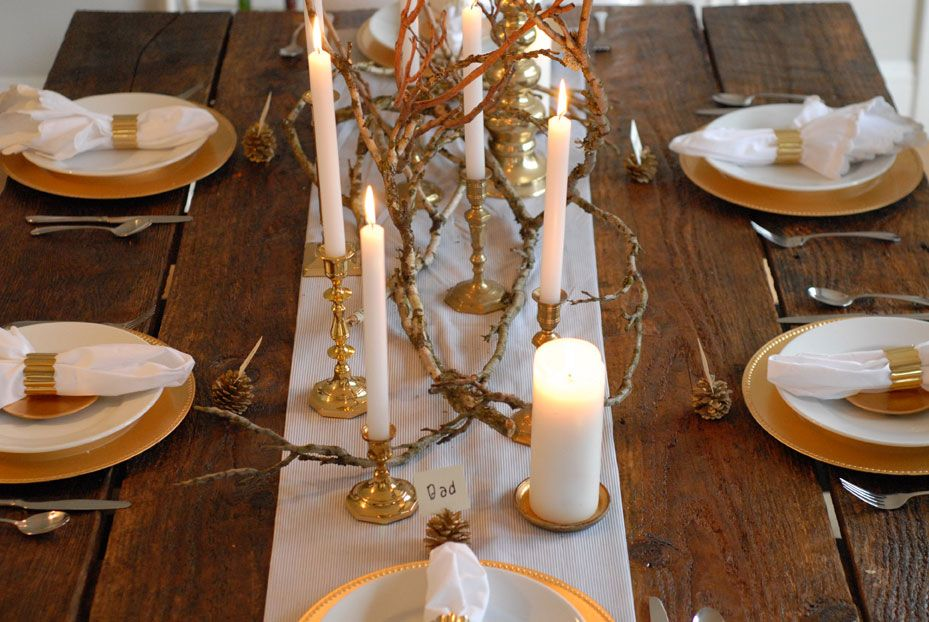 brass candlesticks on wooden farm table