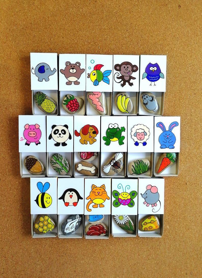 Photo of Alimenta a los animales, juegos en desarrollo, rocas pintadas a mano, caja de cerillas divertida