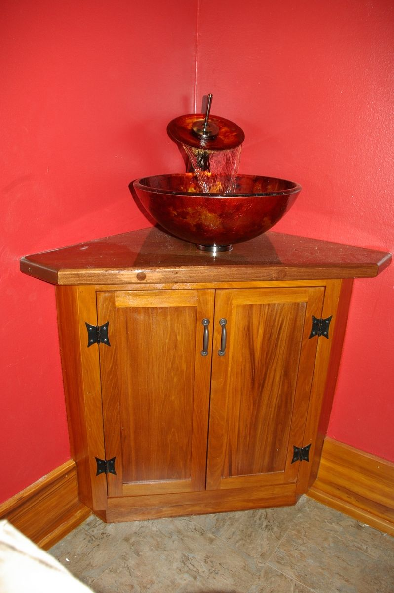 Built in vanity cabinet with maple top.