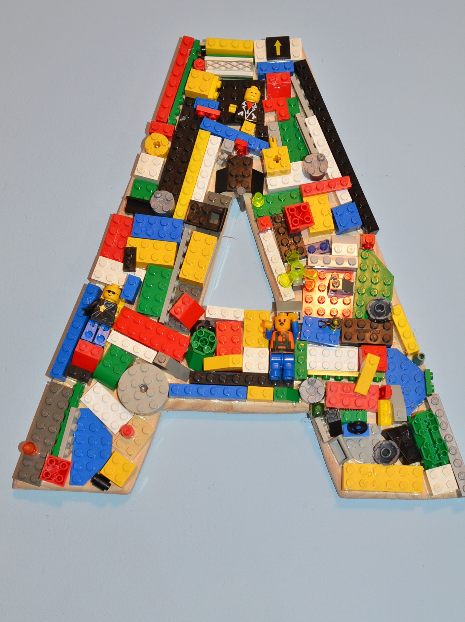 lego room idea hot glue lego to a wooden letter layer on to create