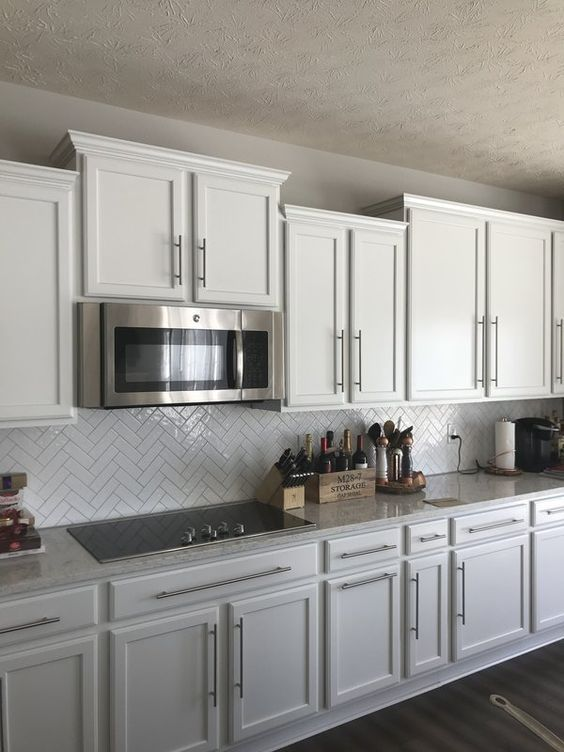 Painting your kitchen cabinets white is a smart design move that will likely keep you satisfied for years to come. Uneven cabinets | Kitchen remodel small, White kitchen design, Kitchen design