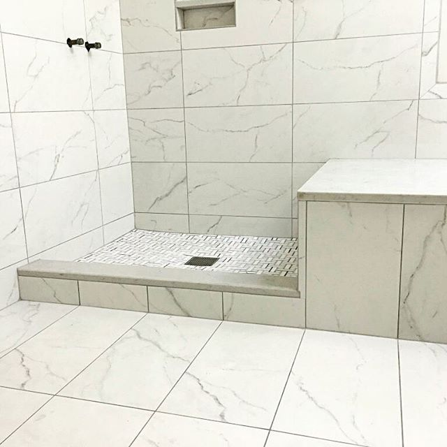 Ceramic And Porcelain Tile Cost And Installation Price Marble Shower Walls Shower Wall Tile Bathroom Remodel Shower