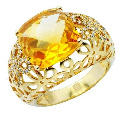 This beautiful cushion cut citrine gemstone is 4-prong set in a handcrafted 14K yellow gold band. The unique floral design of the bulbous band features two diamond encrusted flowers. All of the diamonds are brilliant round cut and prong set.Different ring sizes may be available. Please inquire for details. $649.00