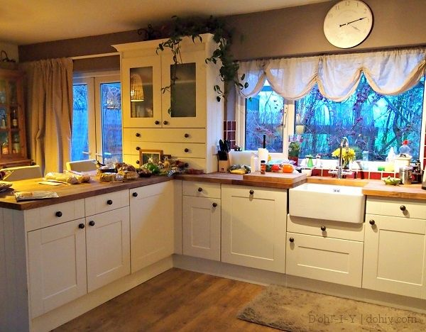 White Country Kitchen With Butcher Block an english kitchen make-over with cream cabinets, butcher block