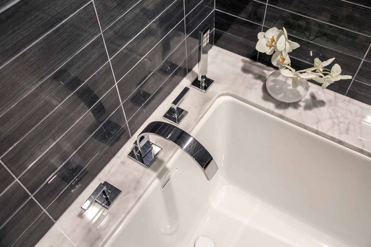 A modern bath masterpiece! Featuring the ROHL Wave Bath Collection ...