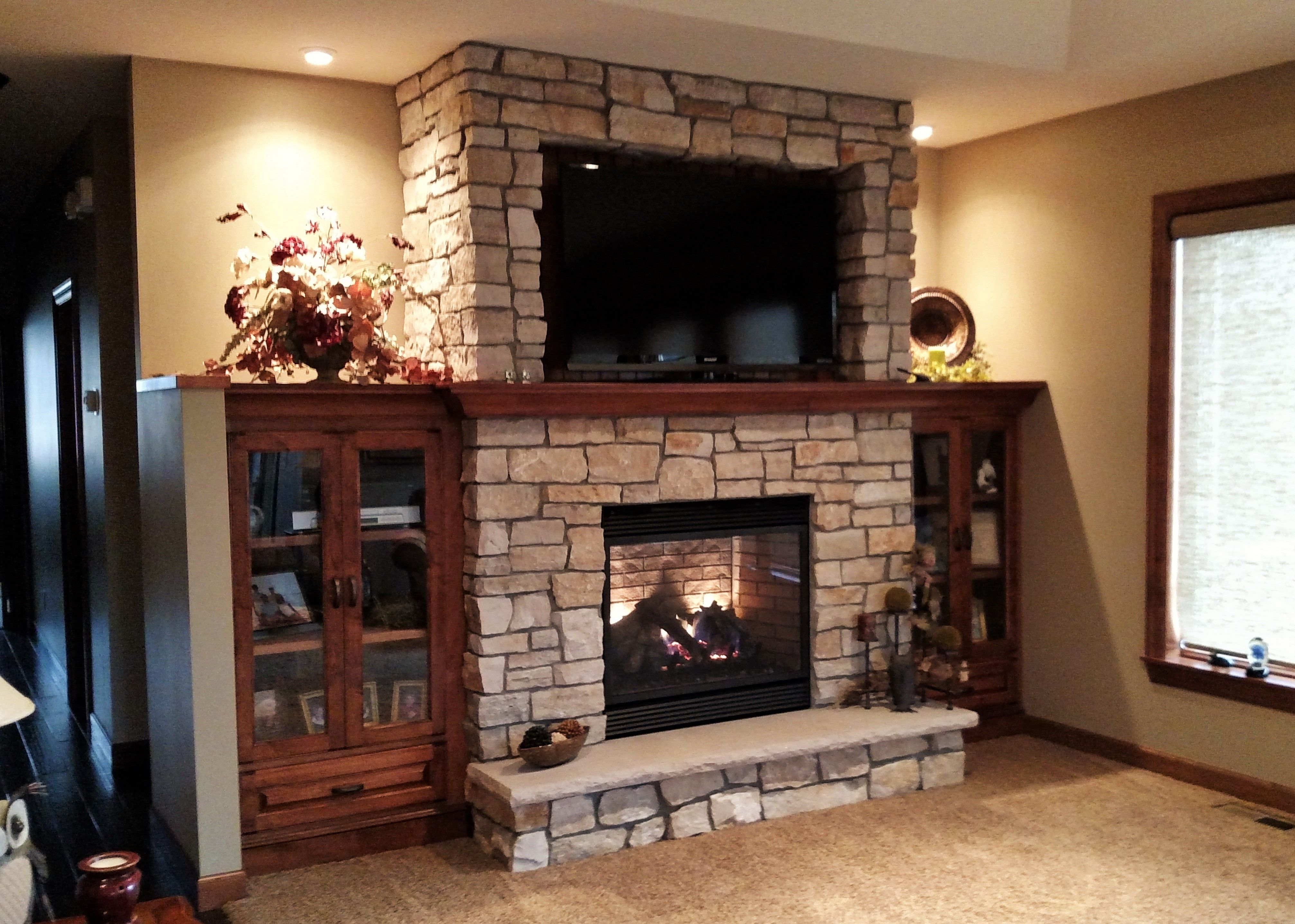 New fireplace with tv eclectic family room minneapolis - Where To Put The Tv Here We Created A Nook In The Stonework And Backed