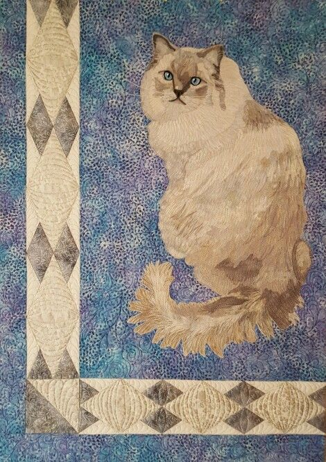 """15 Shades of Sterling"" cat portrait wall quilt."
