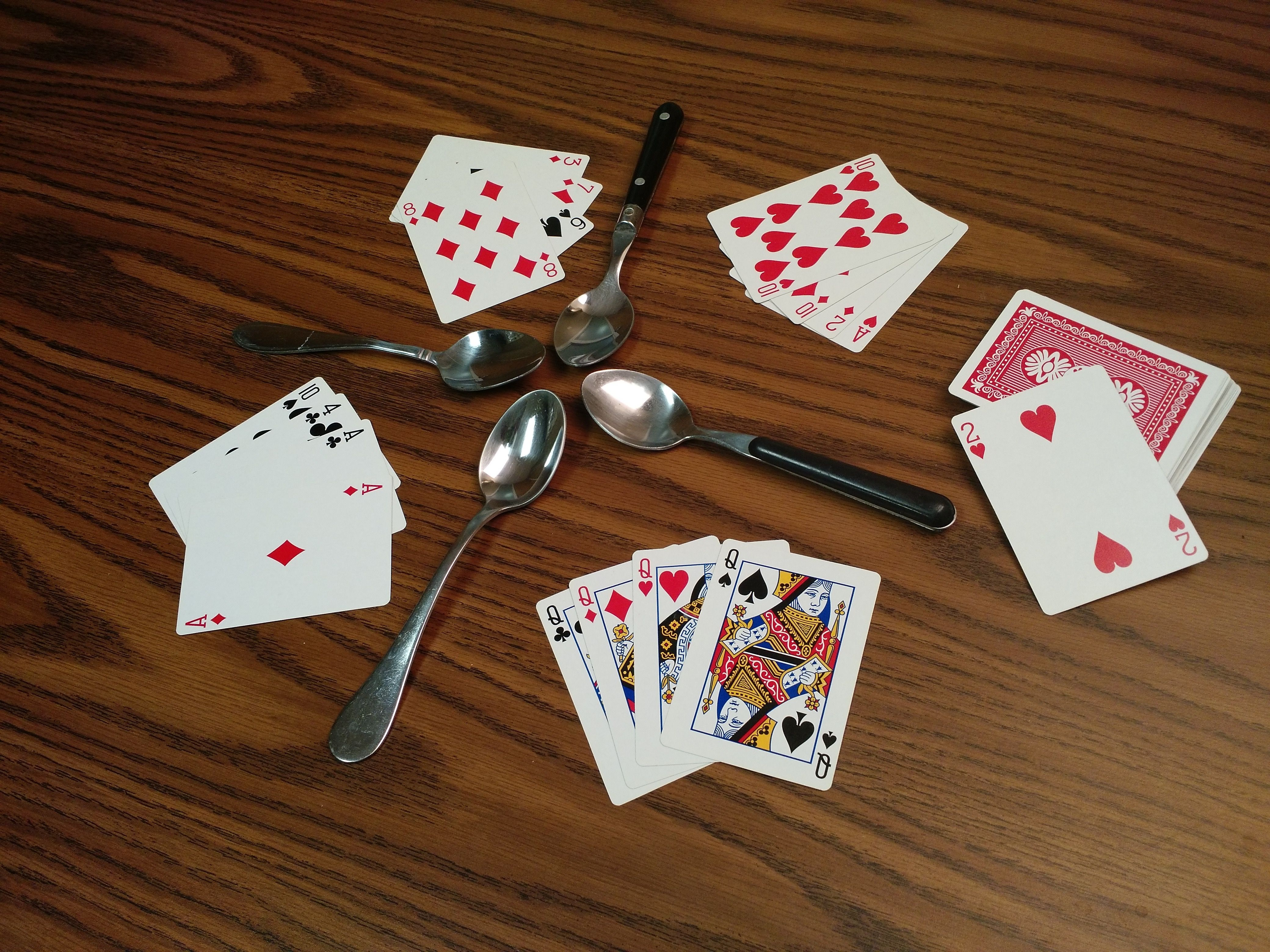 The Game of Spoons   Campfire games, Games, Camping hacks