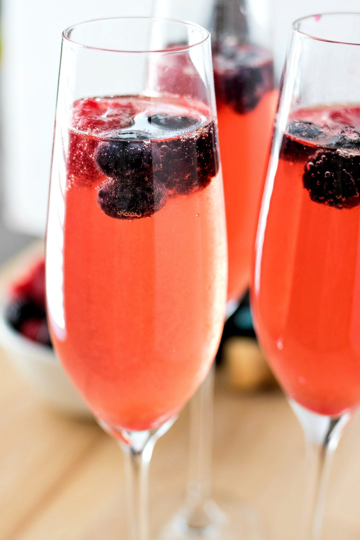 Berry Mimosas A Refreshing And Simple Mimosa Made With Mixed Berry Simple Syrup And Prosecco Or Champagne Garni Tea Party Food Christmas Tea Party Berry Tea