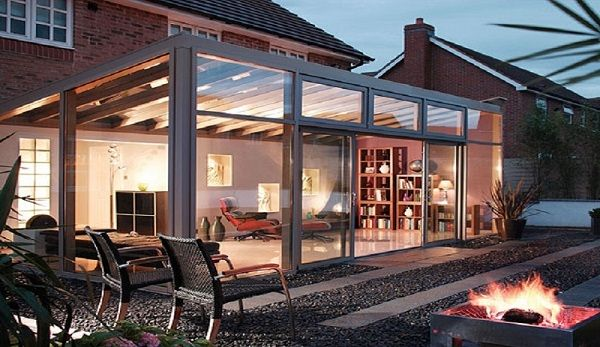 Glass lean-to conservatory at night