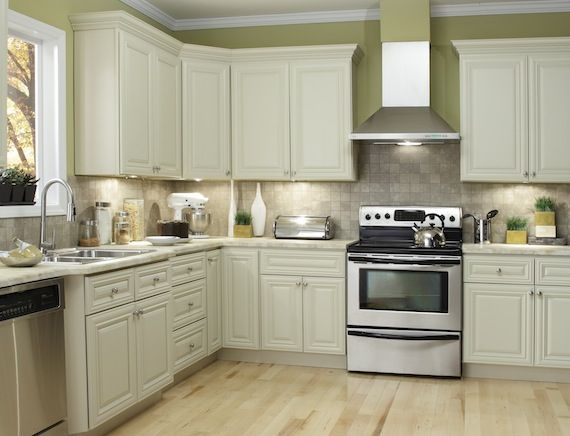 White cabinets with blonde floors, don't like the wall ...