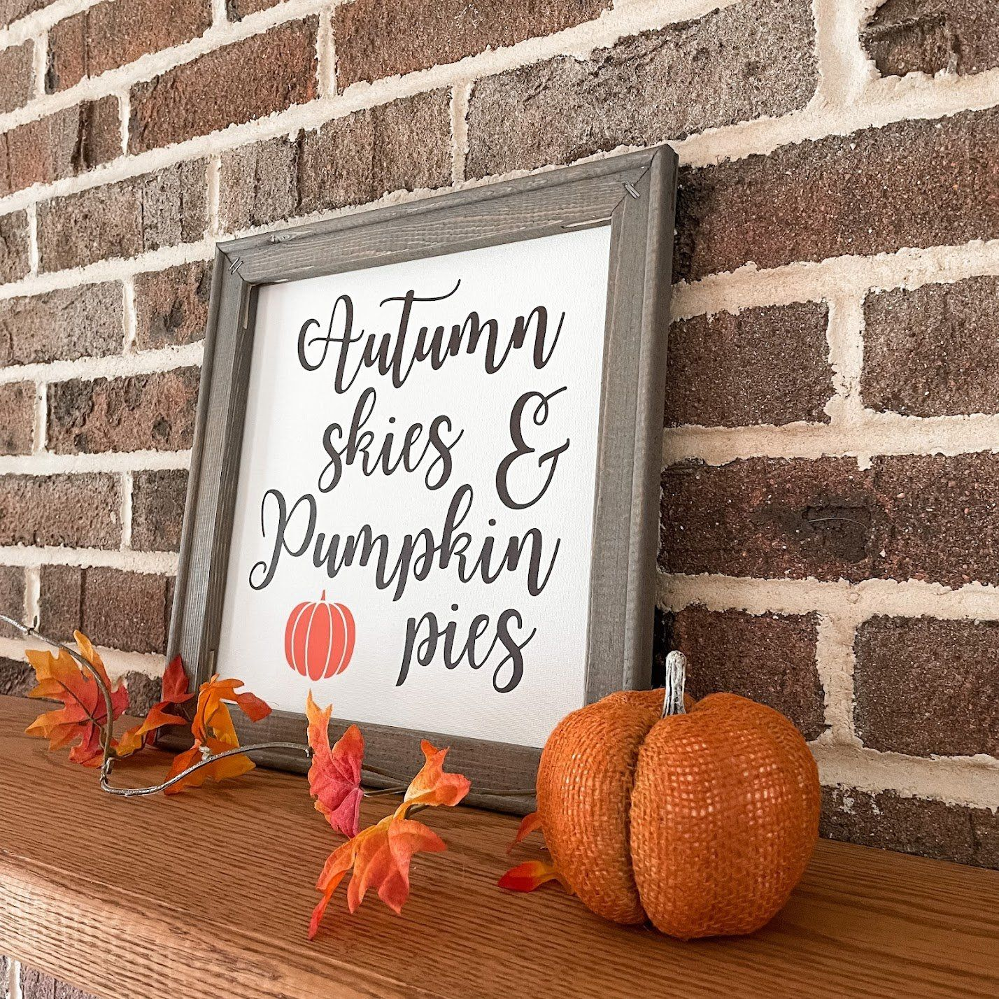 """Autumn Skies & Pumpkin Pies These unique reverse canvas signs are hand pressed with high quality heat transfer vinyl onto canvas. The frames are hand stained with a premium wood stain. Hanging hardware is included. Sign measures 14""""h x 14""""w We love custom orders! Contact us to get started!"""