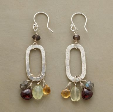 """OH SO OVAL EARRINGS--Each textured sterling silver oval hosts a wire-wound gaggle of gemstones: prehnite, garnet, labradorite and smoky quartz. Handmade for us in USA. 2-1/8""""L."""