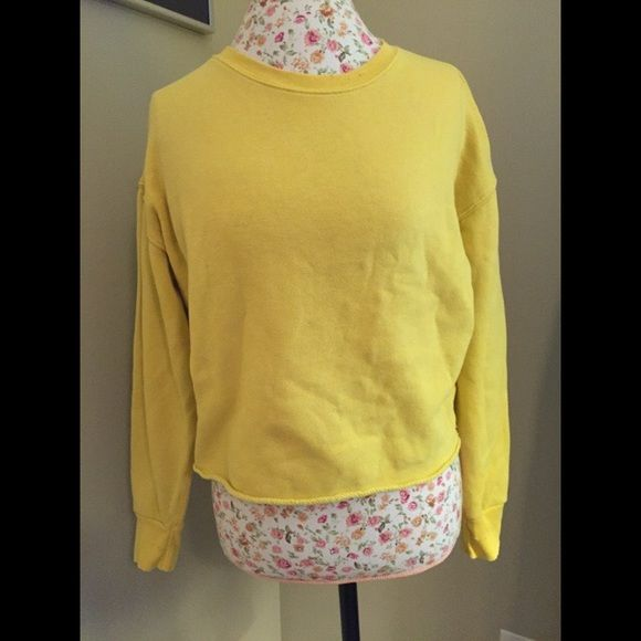 Yellow cropped American Eagle sweatshirt Yellow cropped sweatshirt, lightly worn. The distressed look of the collar and cuffs is the style of the sweatshirt. American Eagle Outfitters Sweaters Crew & Scoop Necks