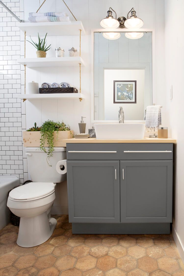 Nice Bathroom Idea Honeycomb Floor Tile White Wall Tile Open White Shelves And Grey Cabinets Bathroom Shelf Decor Bathroom Design Small Bathroom Storage Over Toilet