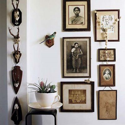 """Salon style portraiture and taxidermy- love the inclusion of the """"admiring"""" bird."""